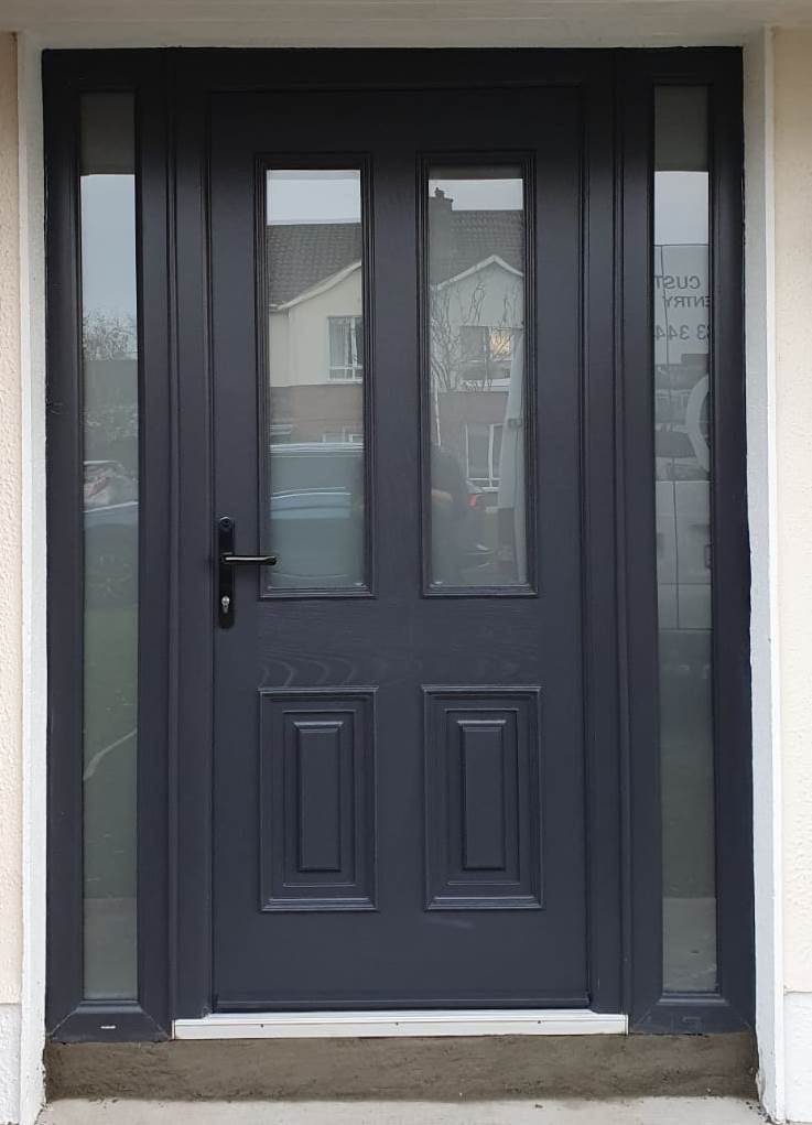 The beautiful Palladio Palmero Composite Front Door with satanized glass and black lever lever handles